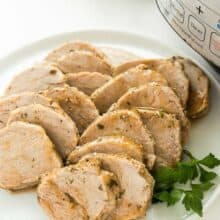 instant pot pork tenderloin on a white plate sliced