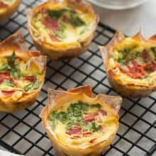 mini quiche made in wonton wrappers on black cooling rack
