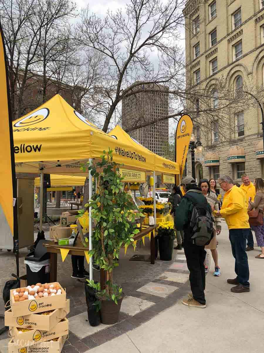 wake up to yellow tent downtown winnipeg manitoba with people standing around