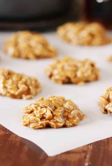 maple no bake cookies on piece of parchment paper on wooden table