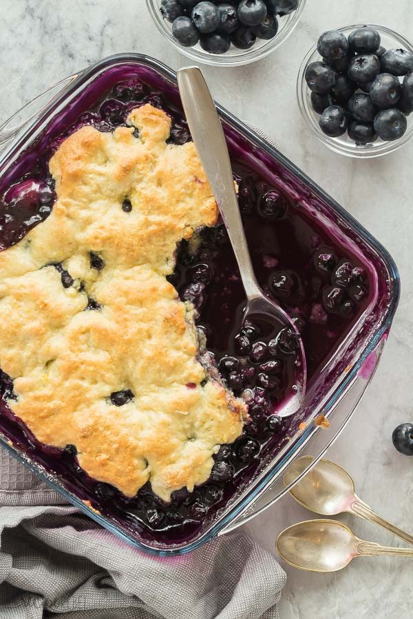 blueberry cobbler in a glass pan overhead