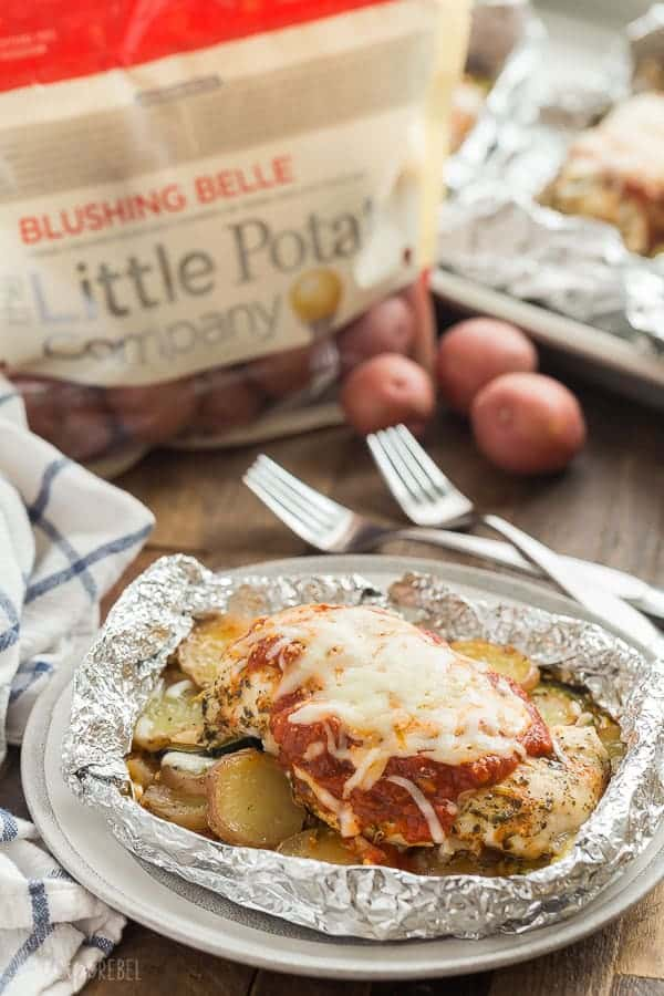 These Chicken Parmesan Foil Packets are loaded with veggies for a full meal deal! The ultimate comfort food made right in one pack, on the grill or in the oven, with almost NO clean up! These chicken foil packets are the perfect make ahead meal for camping or busy summer days. With step by step RECIPE VIDEO #recipe #recipes #video #chicken #chickenbreast #chickenrecipe #grill #grilling #barbecue #cheese #dinner #healthy #foil #camping
