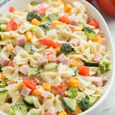 creamy ranch bowtie pasta salad in a large bowl