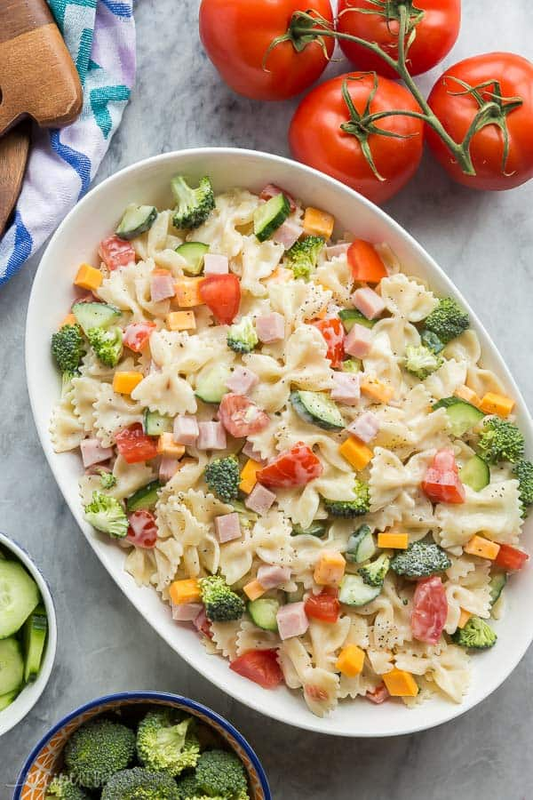 ranch bowtie pasta salad overhead in large white bowl on marble background