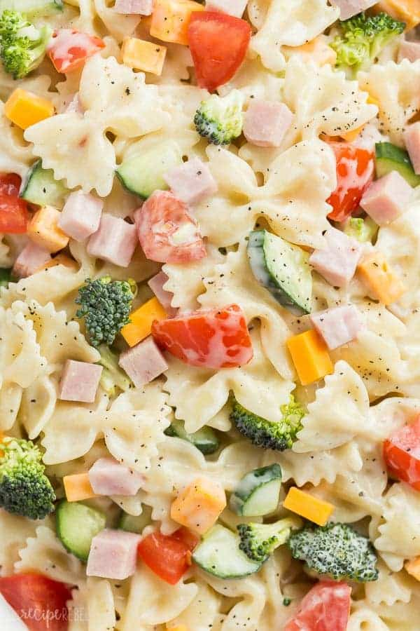 This Creamy Ranch Bowtie Pasta Salad is an easy summer side dish for your barbecue or cookout, or an easy dinner idea! The leftovers make a great cold lunch for school or work, and it keeps well in the fridge. Loaded with your favorite summer veggies and a creamy ranch dressing! #ranch #pasta #pastasalad #salad #barbecue #picnic #recipe