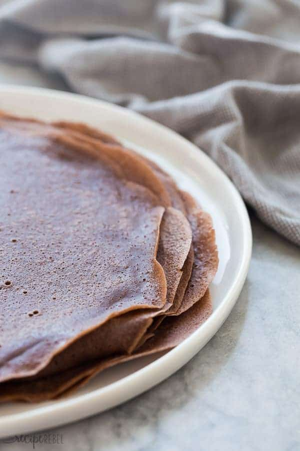 These Easy Chocolate Crepes are a simple but decadent breakfast, brunch or dessert recipe! Fill them any way you want -- with whipped cream, cream cheese, or fresh fruit, this is an easy crepe recipe to make ahead for a special occasion. #chocolate #crepes #breakfast #brunch #dessert