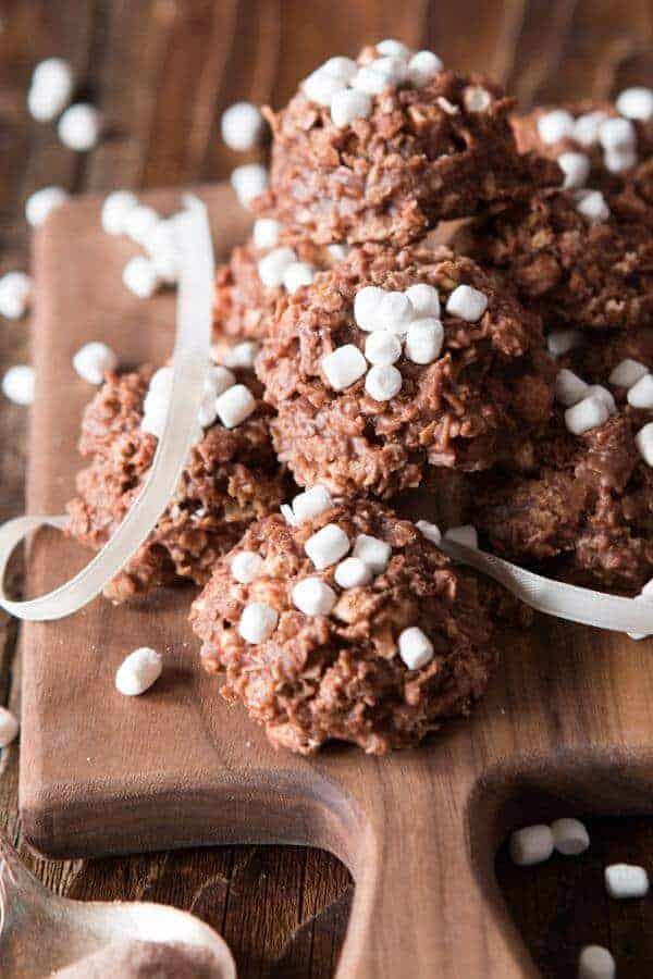 hot cocoa cookies stacked with mini marshmallow bits on top