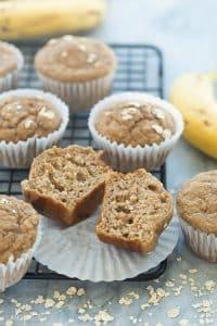 banana oatmeal muffins on a rack cut in half
