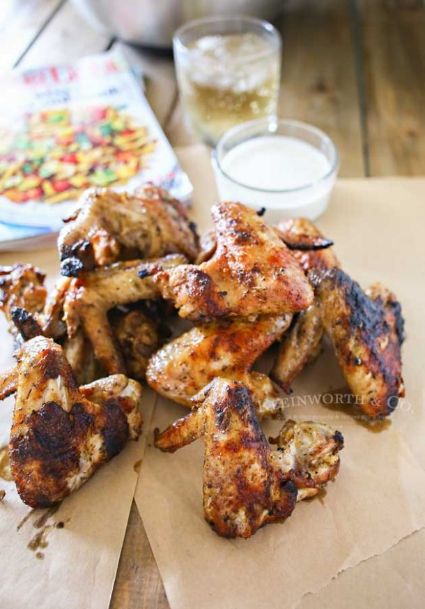 grilled chicken wings on brown parchment paper