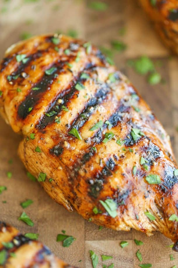 easy grilled chicken breast close up with fresh parsley garnish
