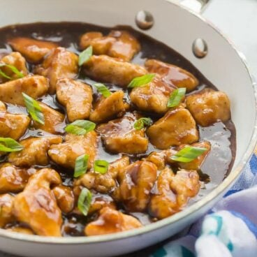 orange chicken in white pan