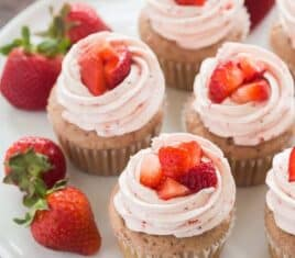 strawberry cupcakes with strawberry swiss meringue buttercream on a plate