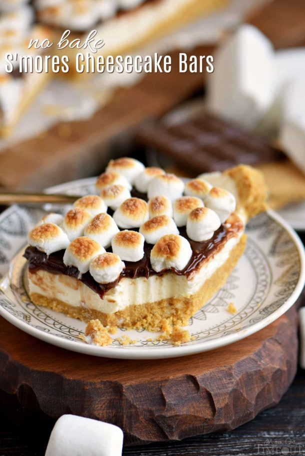 s'mores cheesecake bars with toasted marshmallows on top