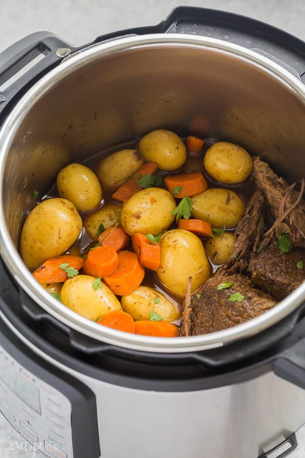 instant pot pot roast in pressure cooker with potatoes and carrots