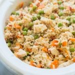 slow cooker chicken and rice in white crockpot