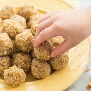 This Tropical No Bake Energy Bites recipe is perfect for back to school! Loaded with dried pineapple, mango, toasted coconut, oats, honey and coconut oil, it's a healthy snack to keep you (and the kids!) going all day long. They're freezer friendly and easy to make ahead. Includes step by step recipe video. #energybites #healthyfood #healthyrecipe #breakfast #snack #recipes
