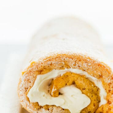 This Lighter Pumpkin Roll is an easier, lighter version of the classic Libby's pumpkin roll. It's made with just a few ingredients but your guests will never know how quickly it came together! Includes step by step recipe video. #pumpkin #cake #dessert #recipe #baking #fall #thanksgiving