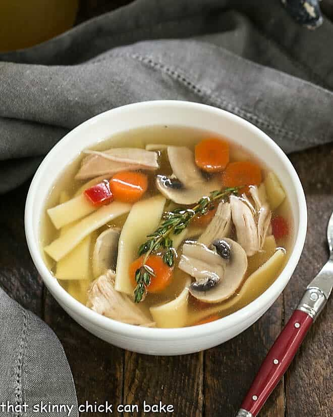 instant pot chicken stock with vegetables in bowl