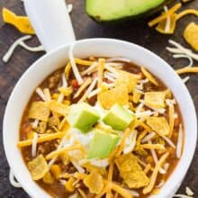 white bowl of instant pot taco soup with cheese on top