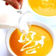 instant pot butternut squash soup with a drizzle of cream