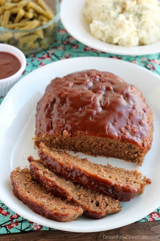 ground beef crock pot meat loaf on white plate with 3 slices cut