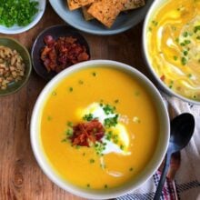 overhead image of bowls of butternut squash apple soup