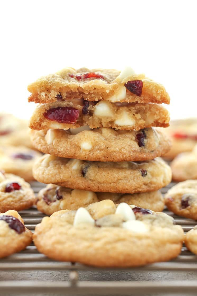 cranberry white chocolate cookies stack with top cookie broken in half