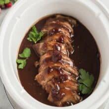 crock pot pork tenderloin with cranberry sauce in slow cooker