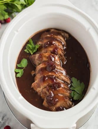 crock pot pork tenderloin with cranberry sauce in slow cooker