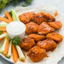 boneless chicken wings with buffalo sauce on white plate