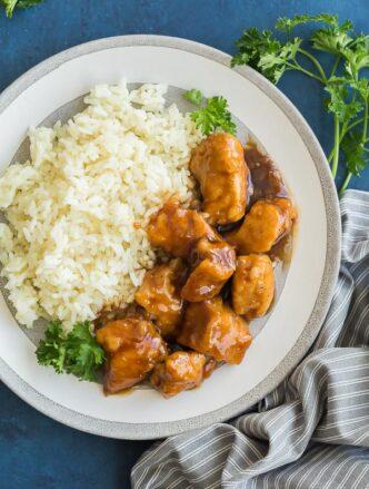crockpot orange chicken on grey plate overhead