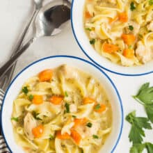 creamy chicken noodle soup in bowls