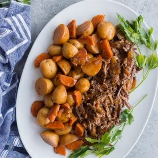slow cooker pot roast on platter