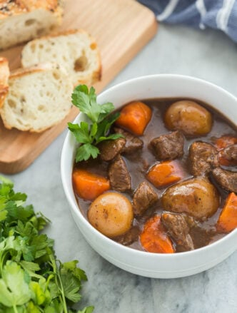 instant pot beef stew in white bowl