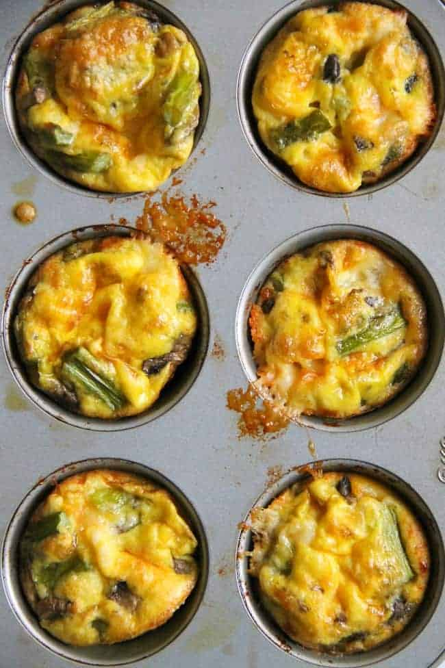 asparagus mushroom cheese egg cups overhead in muffin pan