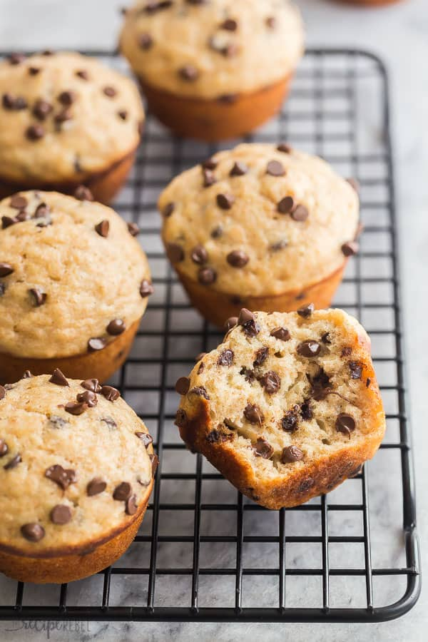 banana chocolate chip muffins on wire rack with one cut in half