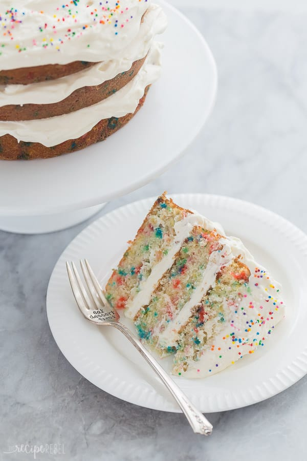 slice of funfetti cake on white plate