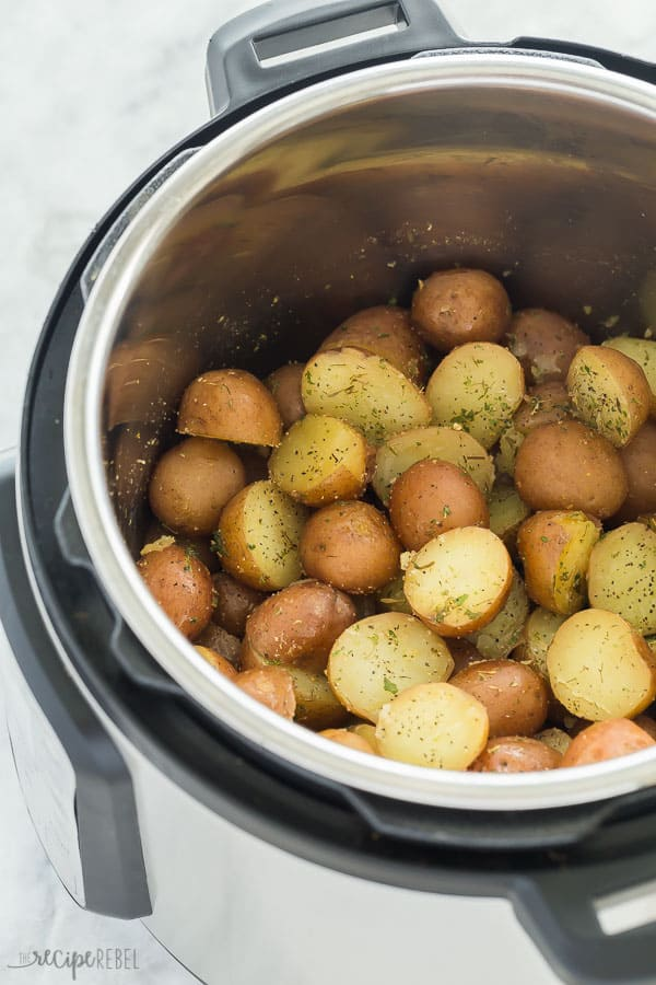 garlic herb instant pot potatoes in pressure cooker on marble background