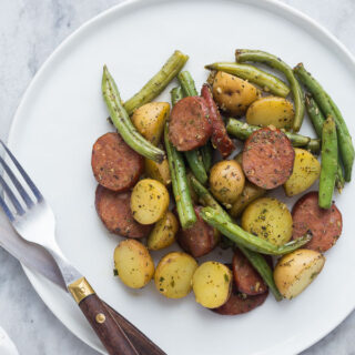 one pan sausage potatoes and green beans on white plate