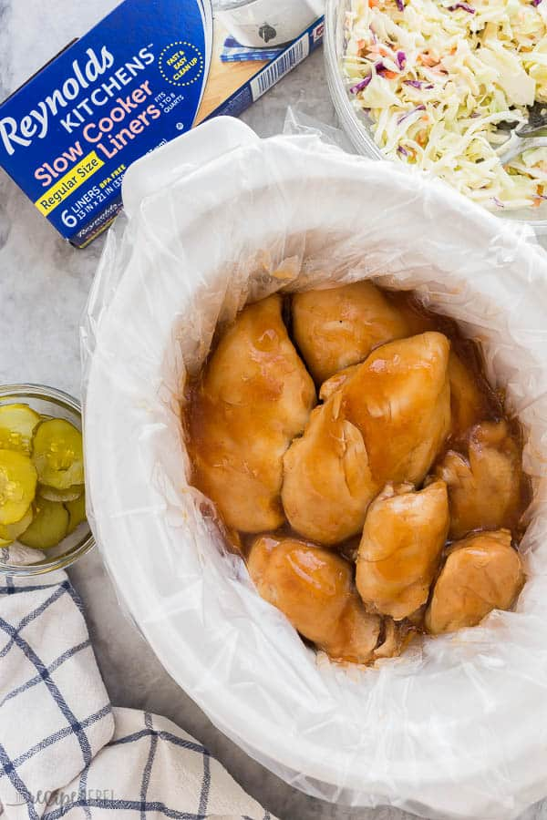 slow cooker bbq chicken in crockpot overhead with slow cooker liner