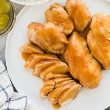 slow cooker bbq chicken on white plate overhead