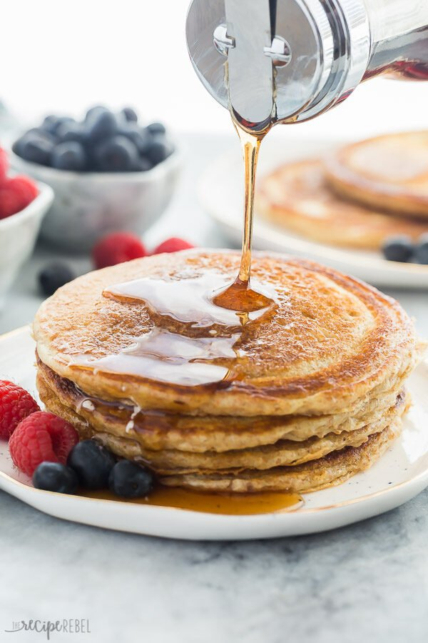 whole wheat pancakes with syrup drizzle