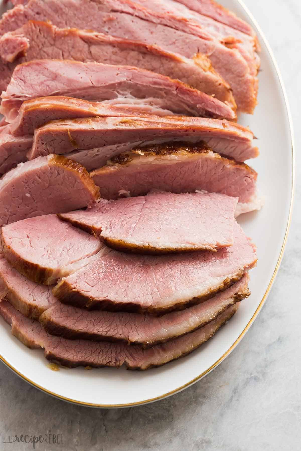 instant pot ham sliced close up on white platter