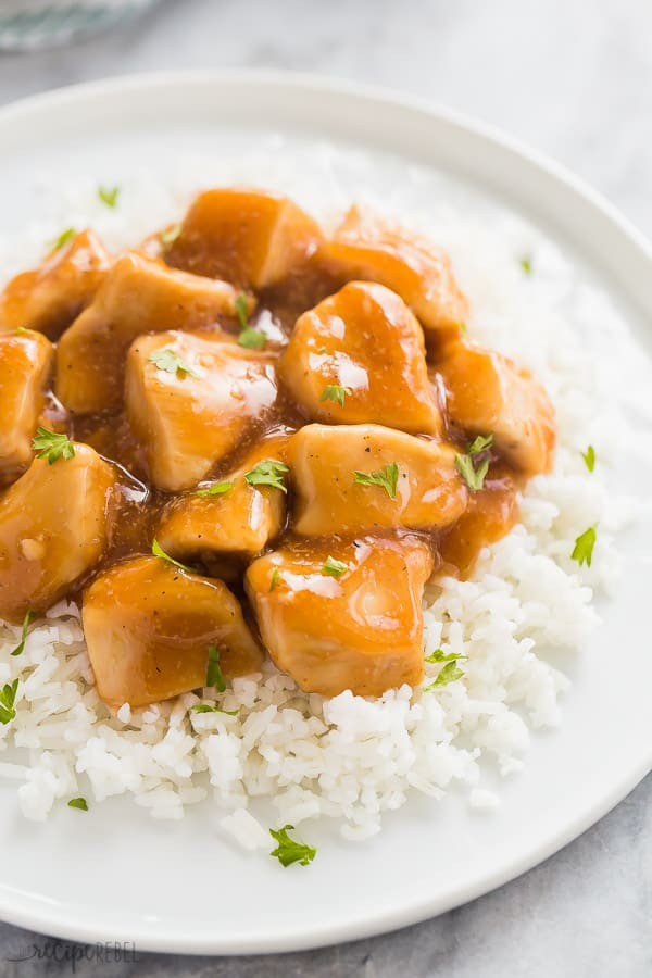 instant pot chicken with honey garlic sauce on white rice on a white plate