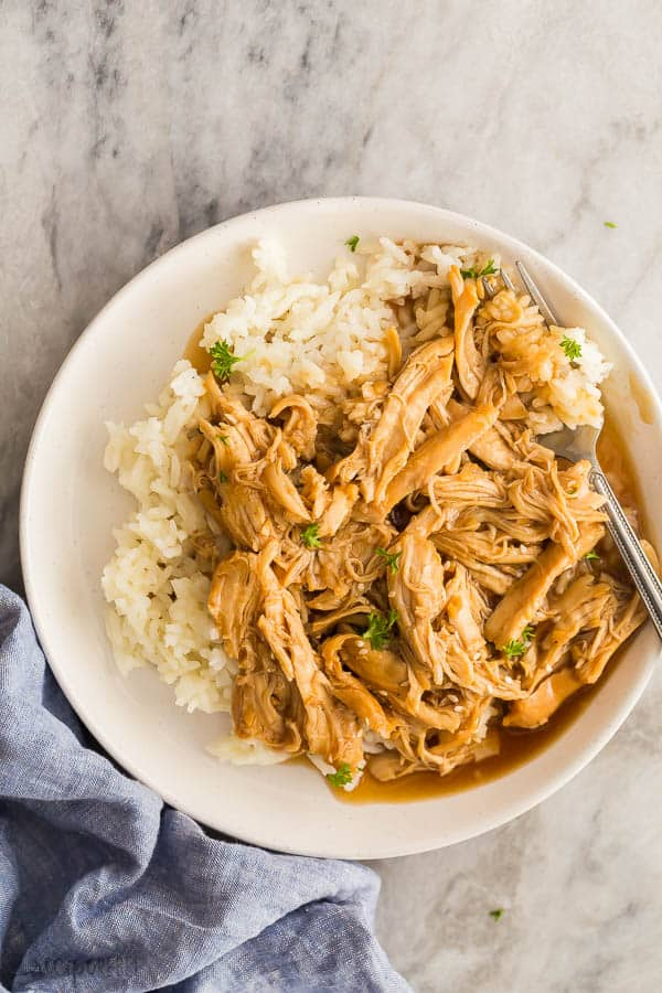 instant pot honey garlic chicken overhead on beige plate with fork stuck in the food