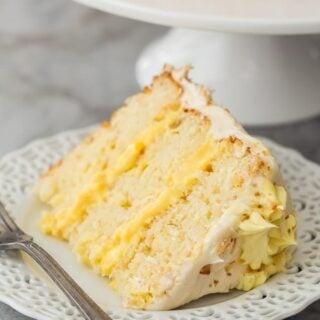 slice of pineapple coconut cake on white plate