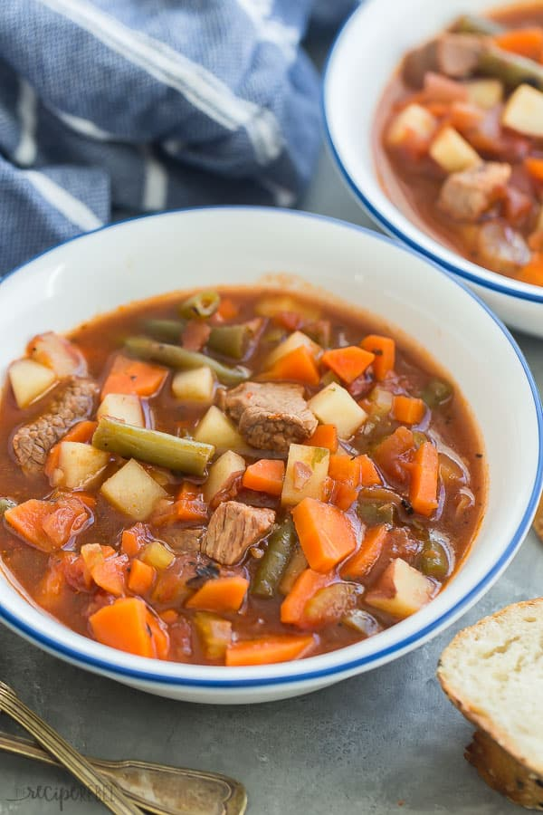 crockpot vegetable soup in a white bowl