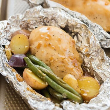 honey garlic chicken foil packets close up