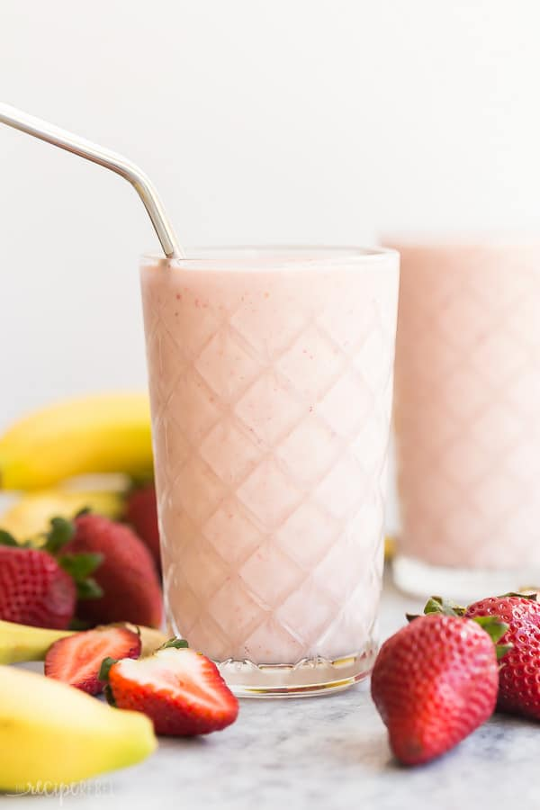 healthy strawberry smoothie with steel straw