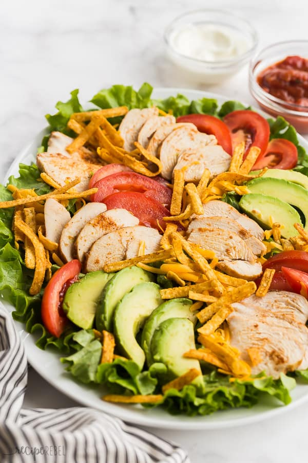 chicken taco salad close up on white plate on white background